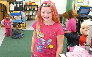 First-grader Morgan Fortner wore pink in her hair for Wear Pink Day, in recognition of Breast Cancer Awareness Month, during Homecoming Spirit Week at Woodland Elementary School. Also showing spirit was her older brother, a fifth grader, who reportedly wore a pink mohawk.