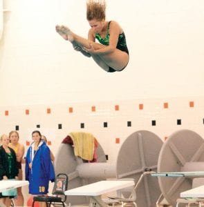 Carman-Ainsworth's Jennifer Messina spotted the water as she rotated through a dive earlier this season at Fenton.