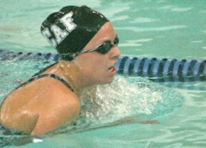 Carman-AInsworth/Flushing's Mara Johnson worked the lane in the breaststroke.