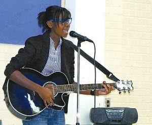Thea Jones (below), junior, sings and plays guitar during rehearsals for the CAHS talent show.
