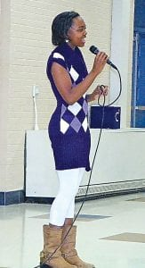 Tahirah Gaines (above) belts out a popular song during rehearsals.