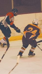 Flushing/C-A's Jordy Makranyi retains possession close to the boards.