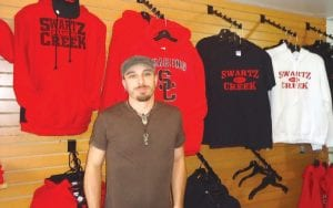 Dan Bennett, of Hankerd Screen Printing, manages the local store.