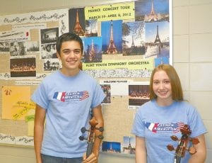 Riley Simmington and Katlyn Koegel, students at Carman-Ainsworth High School, are among 45 Flint Youth Symphony Orchestra musicians raising funds for a cultural exchange trip to France next spring.