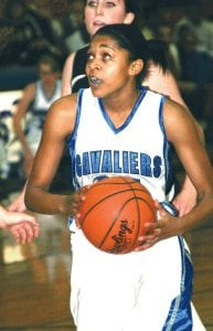 Carman-Ainsworth's Jasmine Jones drives the lane during the Cavaliers' 57-51 season-opening loss on Tuesday at Carman-Ainsworth.