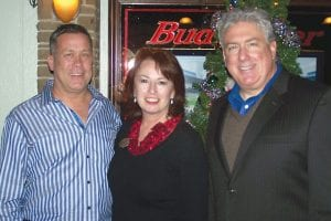 Teddy Bear Patrol organizers Dave Donahue, of Tavern on the Green; Jet Kilmer, president of the Grand Blanc Chamber of Commerce; and Steve Flynn of the Genesee Regional Chamber of Commerce during the recent Teddy Bear Patrol fundraiser at Tavern on the Green.
