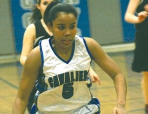 Carman-Ainsworth's Ashley Hall makes her way towards the basket.