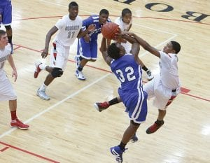 Photo by Andy Novajovsky Carman-Ainsworth's Dorian Grady battles against Grand Blanc at Grand Blanc Tuesday.