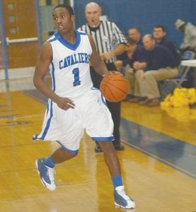 Carman-Ainsworth's Denzell Watts (#1) dribbles the ball up the court.