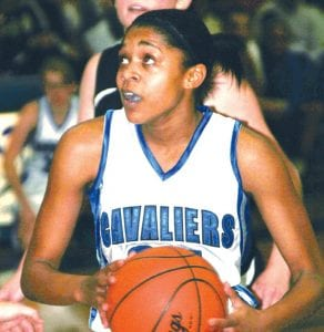Sophomore guard/forward Aliah Stinnett (#34) surveys her options for the Carman-Ainsworth varsity girls' basketball team.
