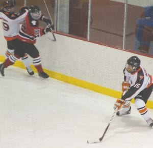 Flushing/Carman-Ainsworth's Mickey Montpas skates behind the Grand Blanc net, looking for an option out in front.
