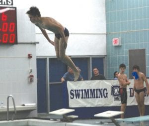 Carman-Ainsworth's Connar Funk flips during a dive attempt.