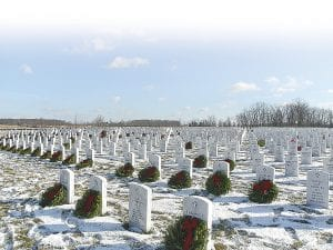 Wreaths were placed at the grave sites of veterans in the Great Lakes National Cemetery in Holly Township.