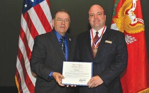 Left, Maj. Gen. Frank Vavala, NGAUS and NGEF chairman, presents Legion de Lafayette certificate to (right) Shawn Mann, Baker College director of military education programs; Mann is wearing the medal presented during the ceremony.