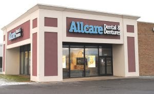 Allcare Dental & Dentures in Flint Township closed its doors suddenly in early 2011, leaving dozens of customers in need of unfinished dental work. Other area dentists stepped up to help those in need. Below: Borders Bookstore in Flint Township closed in September as part of a chainwide bankruptcy.