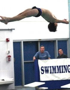 Connar Funck competes for the Carman-Ainsworth varsity boys' swim team in the diving competition at a recent meet.
