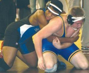 Jerron Thomas (top), here wrestling in a December tournament, went 4-1 at Warren last Saturday.