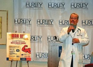 Dr. Paul Musson, a Hurley physician, talks about why men don't take better care of themselves at Hurley's Men's Health Initiative Launch on Friday.