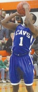Carman-Ainsworth's Denzel Watts shoots one from the free-throw line.