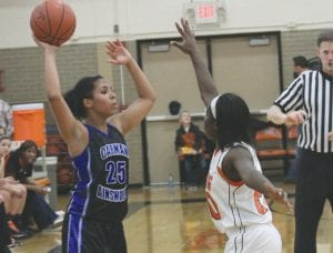 Carman-Ainsworth's Jasmine Jones looks for the pass opportunity.