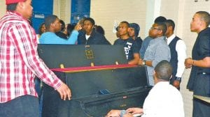 """A PROUD TRADITION CONTINUES — Rehearsing for an upcoming Black History Month Concert at 7 p.m. on Feb. 10, the Carman-Ainsworth African American Students Association Gospel Choir includes alumni who come back each year to participate in the event. A special luncheon also will be held the same day at 2:45 p.m. and will feature guest speaker Isaiah Oliver, a Workforce Development Specialist at Mott Community College who won election last year to the Flint Board of Education. Chane Clingman, AASA advisor, works with the students each year to host the Black History Month events. The Mission of the C-A African American Students Association is to """"promote positive behavior, raise self-esteem, and enrich the school and community through education, outreach, and self-discipline."""""""