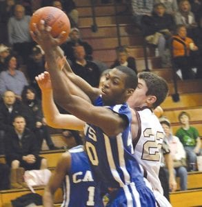 Cavalier Ishman Sims drives the paint for a layup in recent action.