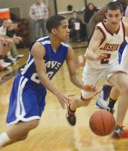 Carman-Ainsworth's Justin Person (#20) drives to the hole earlier this season.