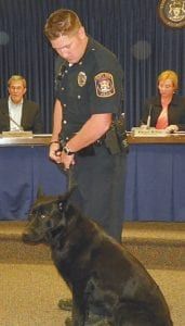 Gunner with his handler, Flint Township Police Ofc. Neal Donovan, in June, 2011.