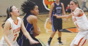 Carman-Ainsworth's Ashley Hall (with the ball) goes hard to the basket.