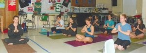 Carrie Mattern leads Yoga Class in relaxing and breathing pose in preparing for MME/ACT testing week.