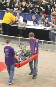 Members of the Flint/Flushing robotics team, Aftershock Team 468, ready its robot for the Rebound Rumble matches March 2-3.