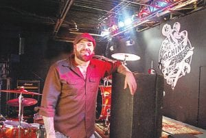 Kevin Zink takes the time to pose behind stage at The Machine Shop.
