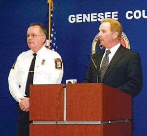Police Chief George Sippert and county prosecutor David Leyton at a press conference Wednesday preceding the arraignment of four people in the March 4 gas station shooting of Leslie Mills, 55, of Grand Blanc.