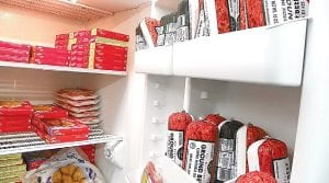 Frozen foods including ground beef, chicken and TV dinners newly stocked in the freezer awaiting those in need.