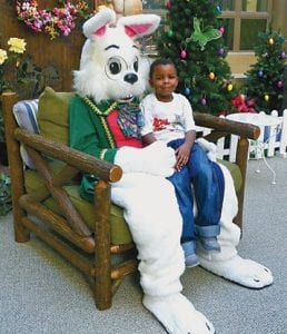 MAKING MEMORIES — LaTavion Knight, 5, of Flint pays a visit to the Easter Bunny who arrived at Genesee Valley Center on Saturday morning. The Easter Bunny will be greeting children at Center Court through April 7 from 10 a.m.-5 p.m. Mon.-Sat. and noon-5 p.m. on Sunday.