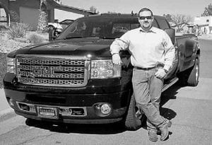 """I live at 7,000 feet above sea level, work at 2,500 feet, and trailer horses and cattle to my ranch up at 9,000 feet,"" said loyal GMC truck buyer John Jay Johns, Jr., who purchased his second HD, a 3500 Denali, at James Wood GMC in Decatur, Texas."