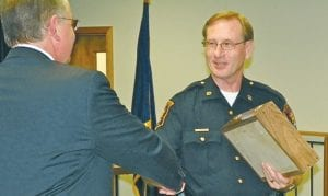 Police Chief George Sippert congratulates Sgt. Norman Loranger who is retiring this week after 25 years of service.