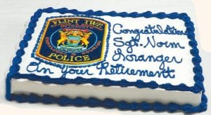 Cake was served during a retirement celebration for Sgt. Norm Loranger after 25 years of service.