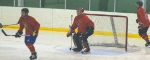 The Carman-Ainsworth goalie stands tall against Davison last Saturday during the alumni tournament.