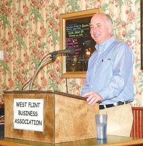 Keith Kirby, president of Curbco talks about his business at the West Flint Business Association meeting last week.