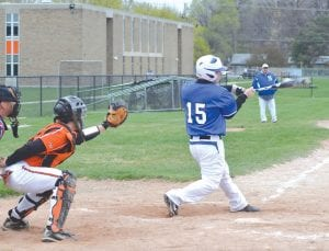 An unidentified Cavalier (roster unavailable) drives the ball against Clio.