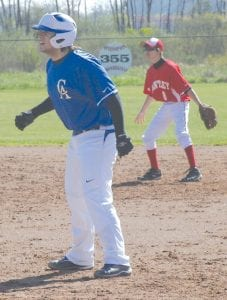 An unidentified Cavalier base runner (roster unavailable) looks to steal second base against Bentley.