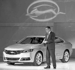 General Motors North America President Mark Reuss smiles after driving the 2014 Chevrolet Impala onto the stage during its world debut at the New York Auto Show last week.