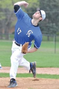 Carman-Ainsworth's Brennon Gleason completes his windup as he delivers the pitch.