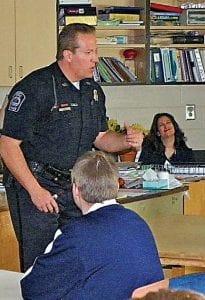Swartz Creek Police officer Ken Szmansky talks to Carman-Ainsworth Middle School students about his career.
