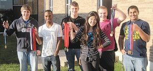 Several CA students won medals in the Science Olympiad. From left to right: John Collins, Jarron McAllister, Tim Woolard (Tall, in the back), Yeonjung Park (girl), Anthony Summers, and Kiran Vekaria.