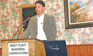 Rick Valley, vice president of NorthGate, describes his business at the West Flint Business Association meeting.