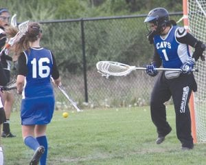 June Hall (#1) guards the net while Hannah Fiewig (#16) comes in to help.