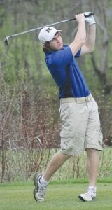 Jack Baker follows through for the Carman-Ainsworth varsity boys' golf team.