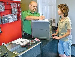 Swartz Creek Computers, formerly Computer Doctors, 8048 Miller Road, is now under new ownership. Above, Michael Diericks, the new owner of Swartz Creek Computers, talks to a customer at the store.